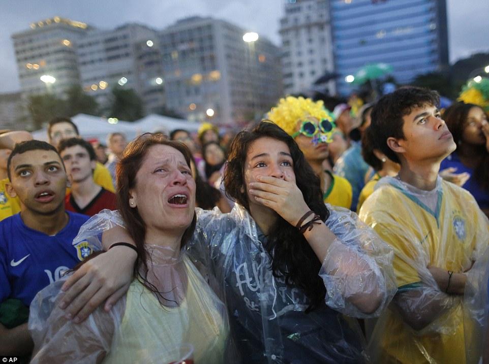 1404854306560_wps_45_Brazil_soccer_fans_cry_as